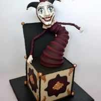 Creepy Jack In The Box The face and body are modeling chocolate and fondant and the box is all cake!
