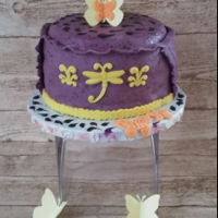 Definitely Purple Made for a ladies luncheon. Cake was lemon orange filled with homemade blueberry jam and iced in orange buttercream with lots of orange...