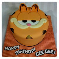 Garfield Cake Yellow cake with chocolate frosting and vanilla fondant