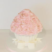 Giant Cupcake Cake Giant Cupcake Cake with pink buttercream, white chocolate liner and gold dust