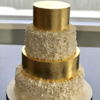 Gold Leaf Wedding Cake All buttercream and smbc with gold leaf.