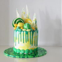 Green And Yellow Drip Cake. For my daughter. This was a very expensive cake. $30 just for the lollies. It was hard to get the colour she wanted.