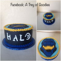 "Halo Cake 8"" round Halo Cake. Frosted in Butter Cream Icing. Drew Halo Helmet in Butter Cream. Halo Logo done in Fondant."