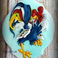 Happy New Year - Rooster Cookie decorated with piped coloured royal icing. Playing with RI it give it a 3 dimensional effect.