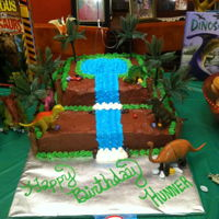 Jurassic Park Cake Dinosaur Cake for my son- edges are also edible, as are rocks.