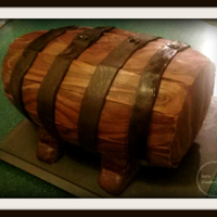 Keg Cake   5 Layers of genoise and molasses buttercream, clad in modeling chocolate to look like a keg