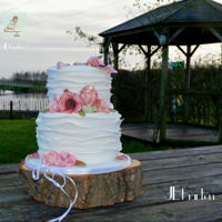 Lovely Winter Wedding Cake winter wedding cake, with ruffles and soft pink/peach flowers.a filling of raspberriescoulis with whitechoolate mousse with mascarpone and...