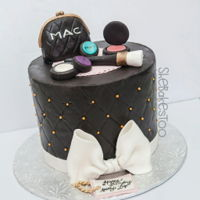 Mac Cake For a makeup lover. Fondant covered cake with fondant and RTK toppers