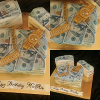 Money Cake!  You would think this is an easy cake to make. However, I cut the cake squares to small and had to improvise on the $100 bills that were...