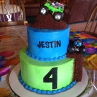 Monster Truck Cake Buttercream cake with toy monster trucks and chocolate cake mud.