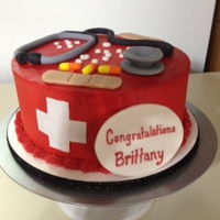 Nursing Cake Buttercream cake with fondant decorations.