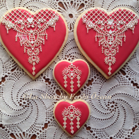 Ophelia In Love Royal iced biscuits/cookies are decorated with Cake Lace OPHELIA mat by Claire Bowman (a UK brand).
