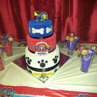 Paw Patrol 3 tier tres leches paw patrol cake and cake pops to match the theme. Fondant paw patrol logo I made. Bones are also fondant.