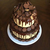 Peanut Butter Cup Chocolate cake with peanut butter frosting, chocolate ganache, and lots of Reese's peanut butter cups