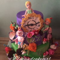 Peter Pan And The 4 Year Old Princess This peter pan cake is for a 4 year old little girl who loves Peter Pan. All figures and flowers are hand made.