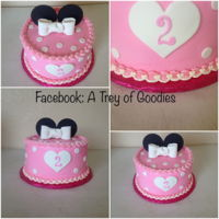 "Pink Minnie Mouse 8"" round Pink Minnie Mouse. Frosted in Butter Cream Icing. Fondant ears and trimmed in Fondant."