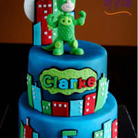 Pj Masks - Gekko This is a 6 & 8 two tier covered in fondant with airbrushed details. The figure, Gekko, is made from fondant. Thanks for looking!