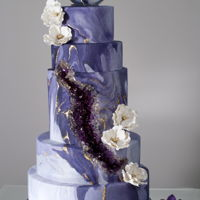 Purple Geode/agate Wedding Cake The inset geode and agate toppers are fully edible, made of sugar.