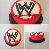 "Raw Wrestling Cake 8"" round Wrestling cake. Iced in Buttercream. Drew W in Buttercream Icing."
