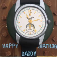 Rolex Watch Cake  A Rolex watch cake for my father's 70th birthday - I carefully reproduced a photo of his favourite watch.Chocolate with pistachio...