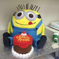 Shaped Minion   This cake was so much fun. His hair is made from raw spaghetti