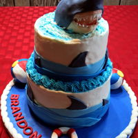 Shark Cake 2 tier cake covered in buttercream with fondant accents and RKT shark covered in modeling chocolate and fondant.