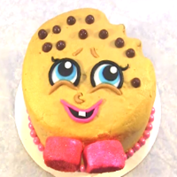 Shopkins Kooky Cookie Dough Cake Has a no egg cookie dough layer between chocolate cake. I covered it in a golden brown buttercream. Her facial features are fondant. I used...