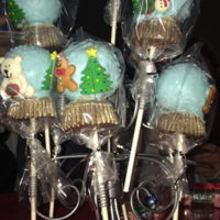 Snow Globe Cake Pops 2016 This was my first attempt at snow globe cake pops. The bases are re-molded medium sized Reeces cups dusted with gold luster dust. The cake...