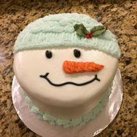 Snowman Buttercream 8-inch round cake. Fondant Holly and Berries.
