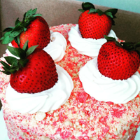 Strawberry Shortcake Cake   Strawberry cake filled with whipped cream and strawberry crunch and topped with fresh strawberries