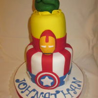 Super Hero Cake Super Hero Cake. Made for a friends son. The Hulks fist on top was made out of rice krispy treats covered in fondant.