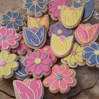 Tulip And Daisy Cookies Tulips and Daisy cookies frosted with royal icing.