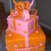 Two Tier Gift Box Cake This was for a baby shower. Her idea was totally simple. She wanted 2 tiers, gift boxes with a box on top. When we discussed flavors, she...