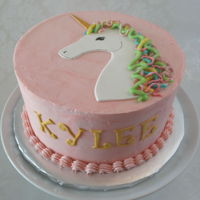 Unicorn Cake Eight inch round in buttercream with fondant unicorn and name.