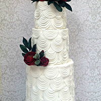 White Drapes And Red Sugar Flowers Wedding Cake My first creation for 2017 is a wedding cake which I decorated using fabric texture such as drapes effect and of course some sugar flowers...