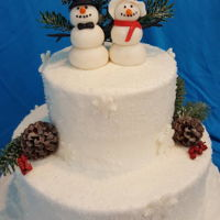 Winter Wedding Winter wedding cake consisting of a decadent chocolate cake with chocolate chip mousse filling and a buttercream frost. Sprinkled course...