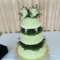 Winter Wedding Cake This is a vanilla cake with whipped white chocolate ganache icing and winter floral decoration.