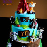 Woodland Creatures This is a 3 tier, 6, 8 & 10, covered in fondant with fondant accents. The animals are handmade from fondant. The tent topper is made...