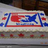 Wrestling Cake I made this cake for a wrestling club. Chocolate & vanilla covered in fondant.