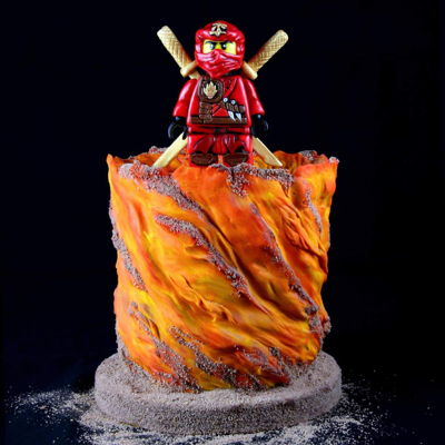 Lego Ninjago Birthday Cake   Figure is made with fondant. Everything's edible.