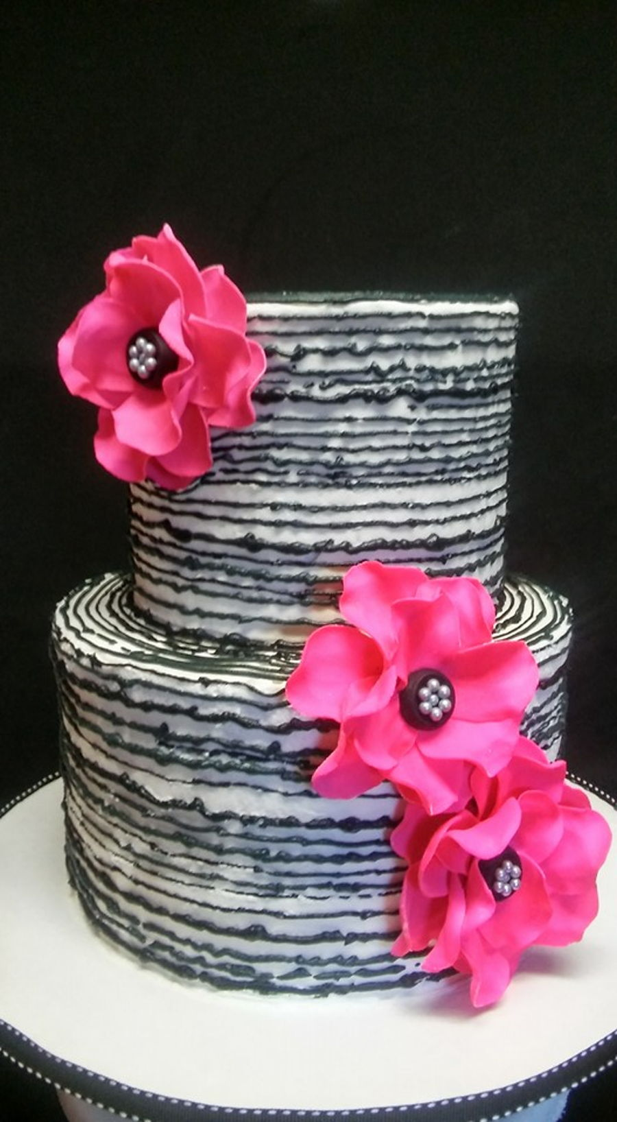 2 tiered black white with fuschia flower cakecentral white buttercream with black buttercream striping fuschia flowers mightylinksfo