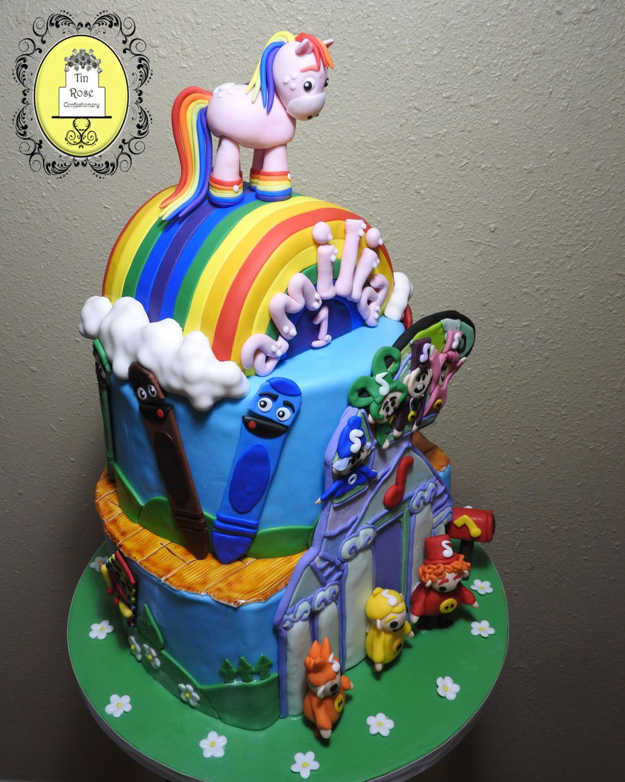 Baby first t v themed birthday cake for Baby tv birthday decoration