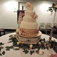 50Th Anniversary This 50th anniversary cake is adorned with gumpaste Roses tipped in gold with fully painted gold leaves. 18-, 14-, 11-, 8-, 5-inch round...