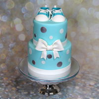 Baby Shower Cake Baby shower cake with sugar baby shoes and sugar bow that was made by my daughter. Julia's Exclusive Cakes https://www.facebook.com/...