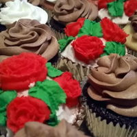 Buttercream Rose Cupcakes Buttercream and chocolate buttercream cupcakes with piped red roses
