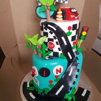 Cars Setting 2 tiers cake with chocolate flavour in both over tier.