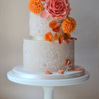Dawn Wedding Cake Autumnal wedding cake with an arrangement of sugar flowers - giant sugar rose, dahlias and calla lily - to reflect the fiery colours of the...