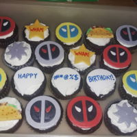 Deadpool Cupcakes Red normal, gray x-force, and blue and yellow x-men logos, shuriken, Wham! stars, tacos, and comic books speech bubbles made from fondant...