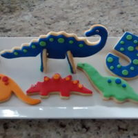 Dinosaur Birthday Cookies NFSC with fondant. 3d Dinosaur cookie and 2d cookies.
