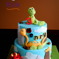 Dinosaurs It's a two tier 6 & 8 covered in fondant with fondant accents. The dinosaurs are made from fondant. Thanks for looking!